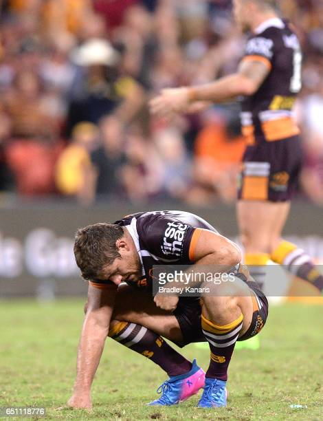 Andrew McCullough of the Broncos looks dejected after his team loses in extra time during the round two NRL match between the Brisbane Broncos and...