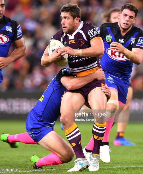Andrew McCullough of the Broncos looks to offload during the round 20 NRL match between the Brisbane Broncos and the Canterbury Bulldogs at Suncorp...