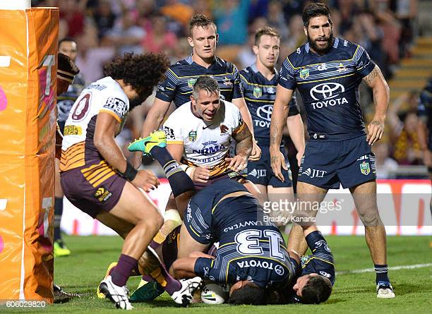 Andrew McCullough of the Broncos scores a try during the first NRL semi final between North Queensland Cowboys and Brisbane Brisbane at 1300SMILES...