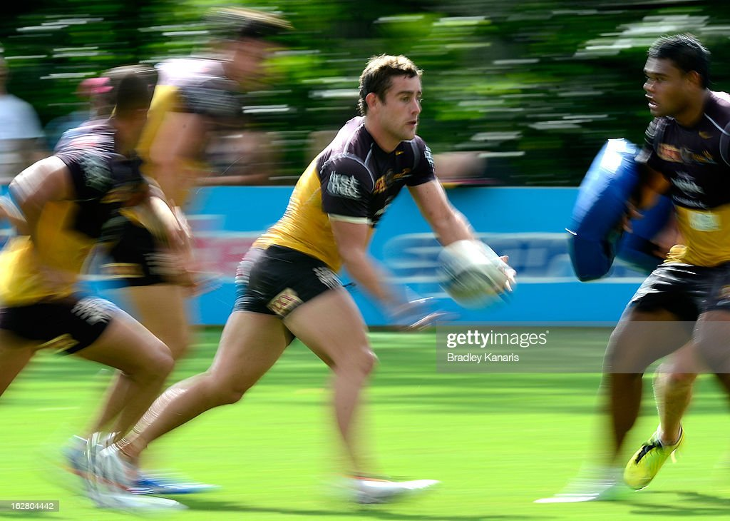 Andrew McCullough passes the ball during a Brisbane Broncos NRL training session on February 28, 2013 in Brisbane, Australia.