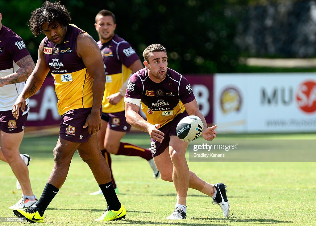 Andrew McCullough passes the ball during a Brisbane Broncos NRL training session on March 7, 2013 in Brisbane, Australia.
