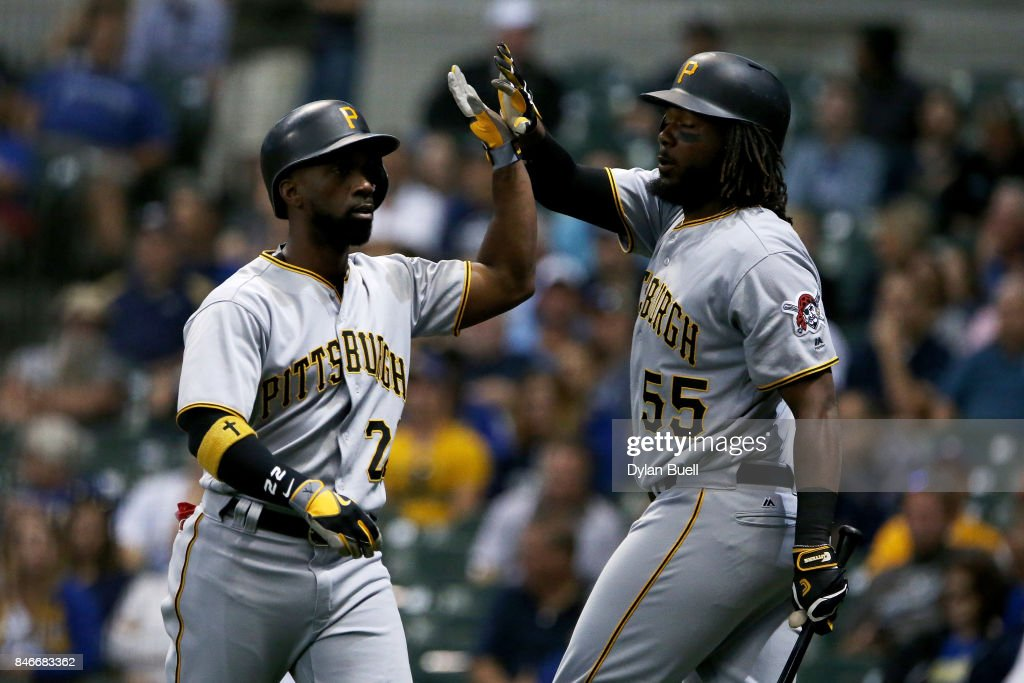 Andrew McCutchen #22 and Josh Bell #55 of the Pittsburgh Pirates celebrate after McCutchen hit his 200th career home run in the first inning against the Milwaukee Brewers at Miller Park on September 13, 2017 in Milwaukee, Wisconsin.