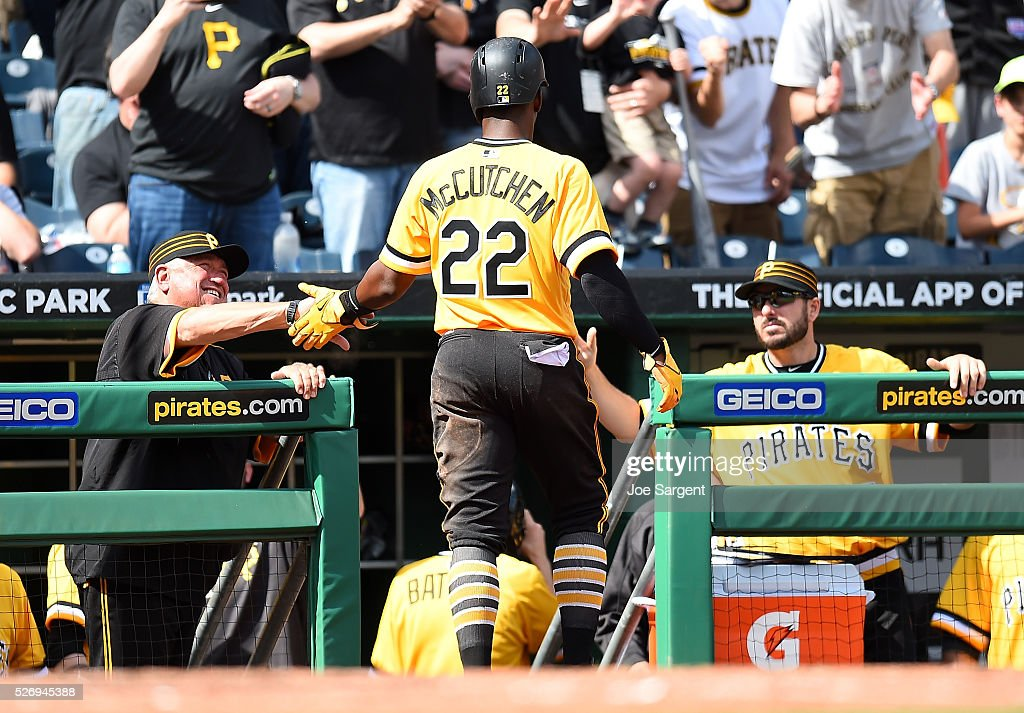 Andrew McCutchen #22 celebrates with manager Clint Hurdle and Matt Joyce #17 of the Pittsburgh Pirates during the eighth inning against the Cincinnati Reds on May 1, 2016 at PNC Park in Pittsburgh, Pennsylvania.