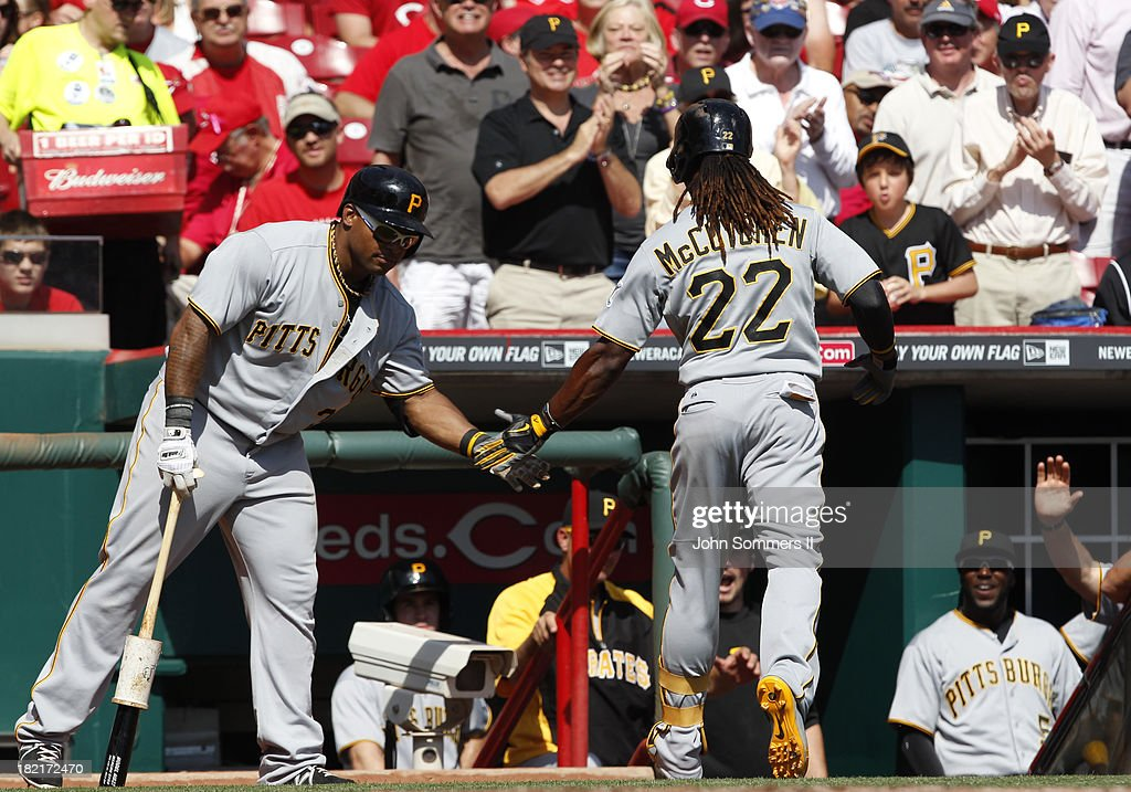 <a gi-track='captionPersonalityLinkClicked' href=/galleries/search?phrase=Andrew+McCutchen&family=editorial&specificpeople=2364814 ng-click='$event.stopPropagation()'>Andrew McCutchen</a> #22 celebrates with <a gi-track='captionPersonalityLinkClicked' href=/galleries/search?phrase=Marlon+Byrd&family=editorial&specificpeople=217377 ng-click='$event.stopPropagation()'>Marlon Byrd</a> # 2 of the Pittsburgh Pirates after hitting a solo home run during their game against the Cincinnati Reds at Great American Ball Park on September 28, 2013 in Cincinnati, Ohio.