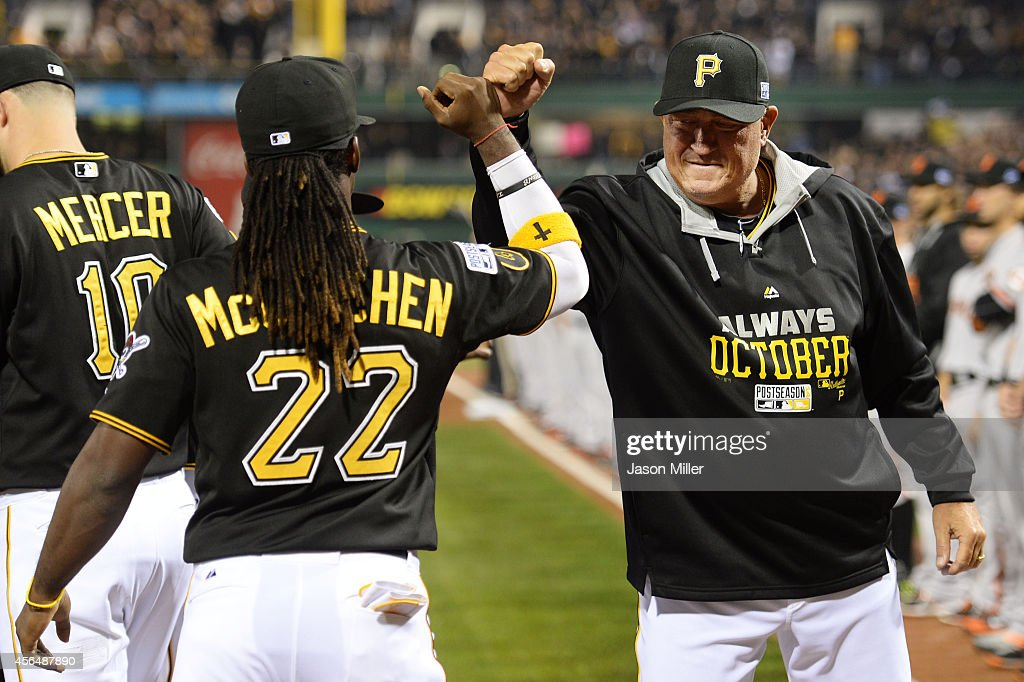 Andrew McCutchen greets manager Clint Hurdle of the Pittsburgh Pirates prior to their National League Wild Card game against the San Francisco Giants...