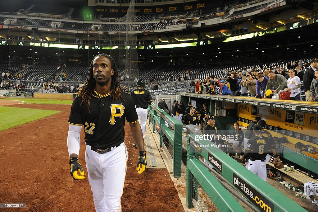 <a gi-track='captionPersonalityLinkClicked' href=/galleries/search?phrase=Andrew+McCutchen&family=editorial&specificpeople=2364814 ng-click='$event.stopPropagation()'>Andrew McCutchen</a> #22 of the Pittsburgh Pirates after hitting a game winning home run against the Milwaukee Brewers at PNC Park on May 14, 2013 in Pittsburgh, Pennsylvania.