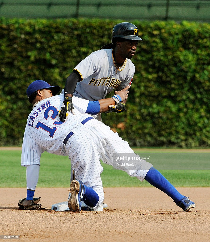 <a gi-track='captionPersonalityLinkClicked' href=/galleries/search?phrase=Andrew+McCutchen&family=editorial&specificpeople=2364814 ng-click='$event.stopPropagation()'>Andrew McCutchen</a> #22 of the Pittsburgh Pirates and <a gi-track='captionPersonalityLinkClicked' href=/galleries/search?phrase=Starlin+Castro&family=editorial&specificpeople=5970945 ng-click='$event.stopPropagation()'>Starlin Castro</a> #13 of the Chicago Cubs get tangled up after McCutchen stole second base in the fourth inning on September 16, 2012 at Wrigley Field in Chicago, Illinois.