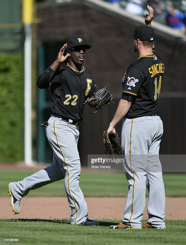 <a gi-track='captionPersonalityLinkClicked' href=/galleries/search?phrase=Andrew+McCutchen&family=editorial&specificpeople=2364814 ng-click='$event.stopPropagation()'>Andrew McCutchen</a> #22 of the Pittsburgh Pirates and teammate <a gi-track='captionPersonalityLinkClicked' href=/galleries/search?phrase=Gaby+Sanchez&family=editorial&specificpeople=4945789 ng-click='$event.stopPropagation()'>Gaby Sanchez</a> #14 celebrate a win over the Chicago Cubs at Wrigley Field on June 7, 2013 in Chicago, Illinois. The Pirates defeated the Cubs 2-0.
