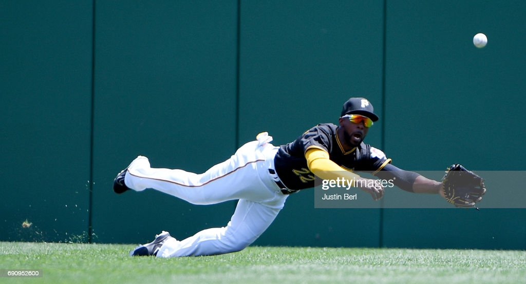 Andrew McCutchen #22 of the Pittsburgh Pirates can't come up with a ball off the bat of Jake Lamb #22 of the Arizona Diamondbacks in the third inning at PNC Park on May 31, 2017 in Pittsburgh, Pennsylvania.