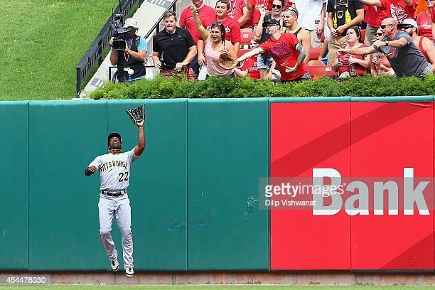 Andrew McCutchen of the Pittsburgh Pirates catches a deep fly ball in the fourth inning against the St Louis Cardinals at Busch Stadium on September...