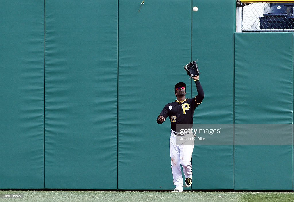 Andrew McCutchen #22 of the Pittsburgh Pirates catches a fly ball against the Chicago Cubs during the opening day game on April 1, 2013 at PNC Park in Pittsburgh, Pennsylvania. The Cubs defeated the Pirates 3-1.