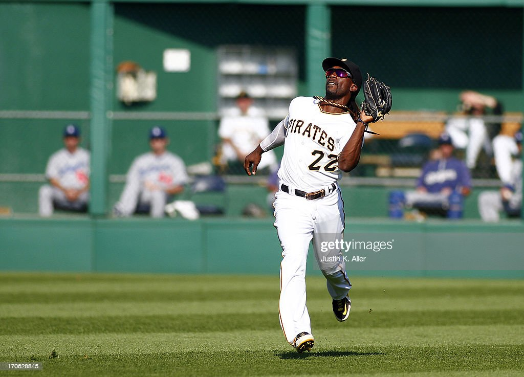 Andrew McCutchen #22 of the Pittsburgh Pirates catches a fly ball against the Los Angeles Dodgers during the game on June 15, 2013 at PNC Park in Pittsburgh, Pennsylvania.