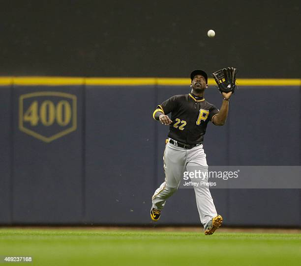 Andrew McCutchen of the Pittsburgh Pirates catches a fly ball against the Milwaukee Brewers in the second inning at Miller Park on April 10 2015 in...