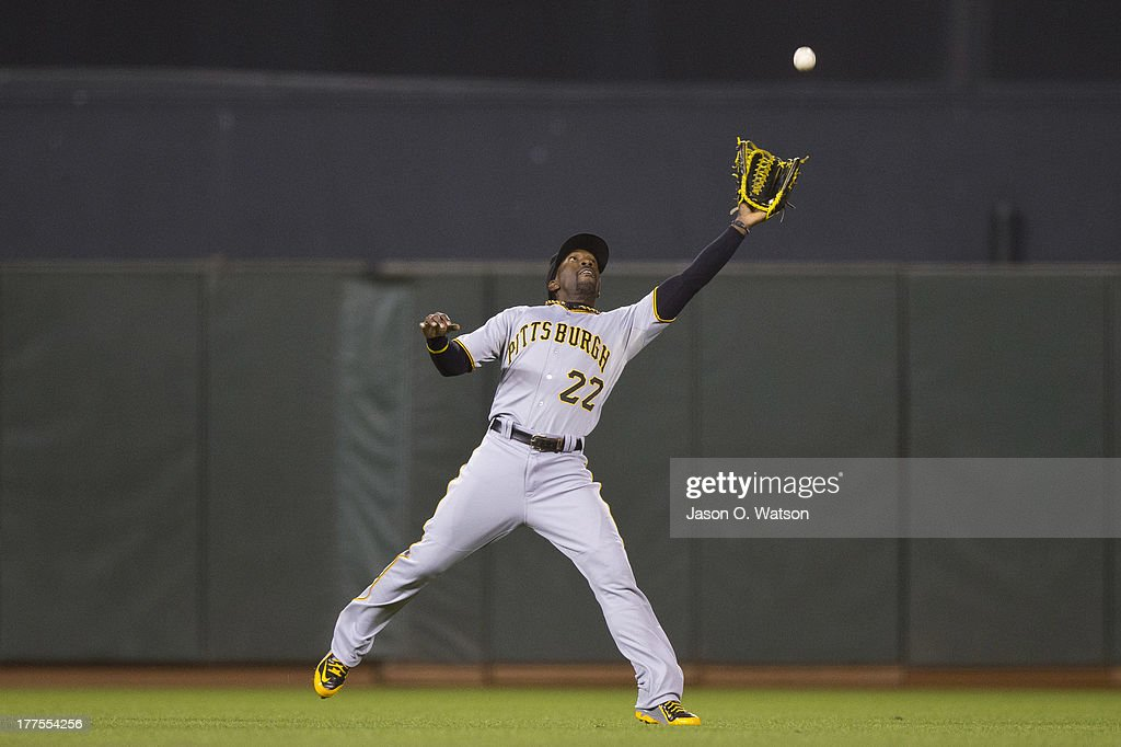 <a gi-track='captionPersonalityLinkClicked' href=/galleries/search?phrase=Andrew+McCutchen&family=editorial&specificpeople=2364814 ng-click='$event.stopPropagation()'>Andrew McCutchen</a> #22 of the Pittsburgh Pirates catches a fly ball hit off the bat of Brandon Crawford of the San Francisco Giants (not pictured) during the fifth inning at AT&T Park on August 23, 2013 in San Francisco, California.
