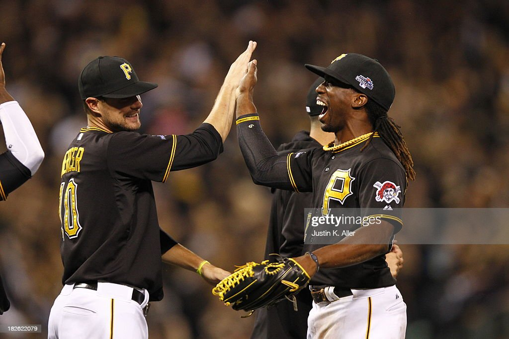 <a gi-track='captionPersonalityLinkClicked' href=/galleries/search?phrase=Andrew+McCutchen&family=editorial&specificpeople=2364814 ng-click='$event.stopPropagation()'>Andrew McCutchen</a> #22 of the Pittsburgh Pirates celebrates after defeating the Cincinnati Reds 6-2 in the National League Wild Card game at PNC Park October 1, 2013 in Pittsburgh, Pennsylvania.