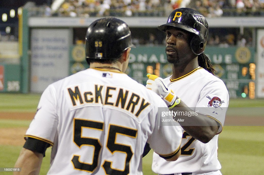 <a gi-track='captionPersonalityLinkClicked' href=/galleries/search?phrase=Andrew+McCutchen&family=editorial&specificpeople=2364814 ng-click='$event.stopPropagation()'>Andrew McCutchen</a> #22 of the Pittsburgh Pirates celebrates after hitting a solo home run in the fourth inning against the Los Angeles Dodgers during the game on August 15, 2012 at PNC Park in Pittsburgh, Pennsylvania.