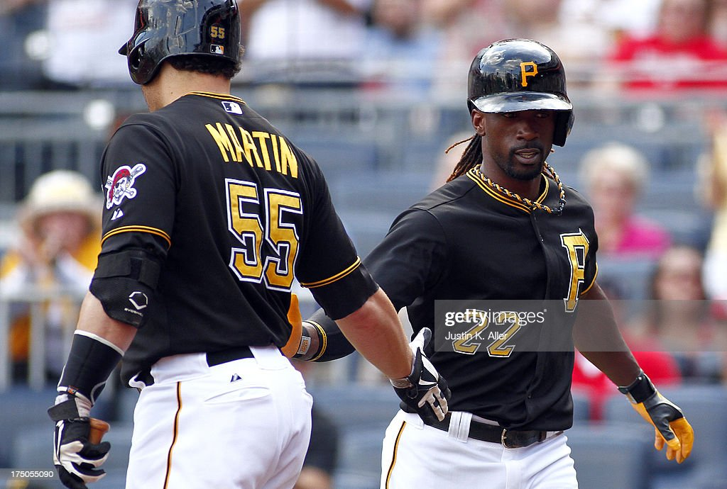 <a gi-track='captionPersonalityLinkClicked' href=/galleries/search?phrase=Andrew+McCutchen&family=editorial&specificpeople=2364814 ng-click='$event.stopPropagation()'>Andrew McCutchen</a> #22 of the Pittsburgh Pirates celebrates after scoring on an RBI double by teammate Pedro Alvarez #24 in the first inning against the St. Louis Cardinals during the game on July 30, 2013 at PNC Park in Pittsburgh, Pennsylvania.