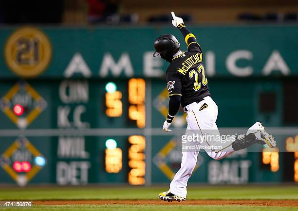 Andrew McCutchen of the Pittsburgh Pirates celebrates his gametying solo home run in the eighth inning against the Minnesota Twins during the game at...