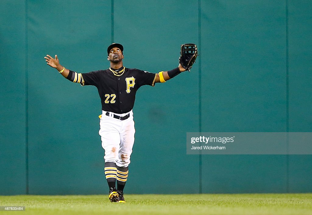 <a gi-track='captionPersonalityLinkClicked' href=/galleries/search?phrase=Andrew+McCutchen&family=editorial&specificpeople=2364814 ng-click='$event.stopPropagation()'>Andrew McCutchen</a> #22 of the Pittsburgh Pirates celebrates their 6-3 win against the Milwaukee Brewers during the game at PNC Park on September 11, 2015 in Pittsburgh, Pennsylvania.