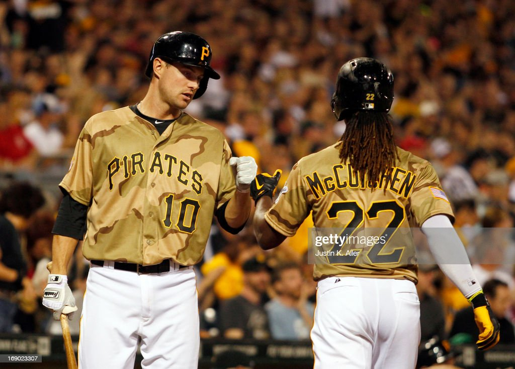 <a gi-track='captionPersonalityLinkClicked' href=/galleries/search?phrase=Andrew+McCutchen&family=editorial&specificpeople=2364814 ng-click='$event.stopPropagation()'>Andrew McCutchen</a> #22 of the Pittsburgh Pirates celebrates with Jordy Mercer #10 after scoring on an RBI single in the sixth inning against the Houston Astros during the game on May 18, 2013 at PNC Park in Pittsburgh, Pennsylvania.