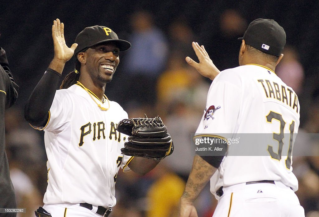 <a gi-track='captionPersonalityLinkClicked' href=/galleries/search?phrase=Andrew+McCutchen&family=editorial&specificpeople=2364814 ng-click='$event.stopPropagation()'>Andrew McCutchen</a> #22 of the Pittsburgh Pirates celebrates with <a gi-track='captionPersonalityLinkClicked' href=/galleries/search?phrase=Jose+Tabata&family=editorial&specificpeople=759093 ng-click='$event.stopPropagation()'>Jose Tabata</a> #31 after defeating the Atlanta Braves on October 2, 2012 at PNC Park in Pittsburgh, Pennsylvania. The Pirates defeated the Braves 5-1.