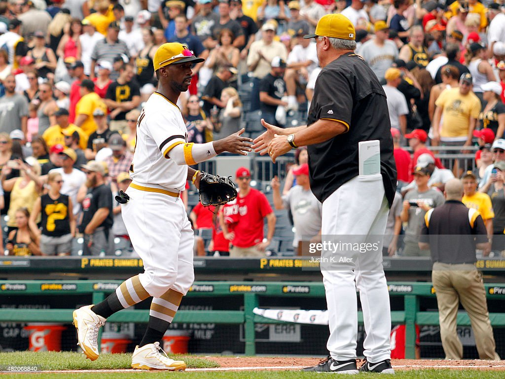Andrew McCutchen of the Pittsburgh Pirates celebrates with manager Clint Hurdle after defeating the Washington Nationals 31 at PNC Park on July 26...