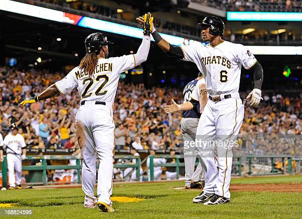 Andrew McCutchen of the Pittsburgh Pirates celebrates with Starling Marte after both scoring on a two run single by Neil Walker in the sixth inning...
