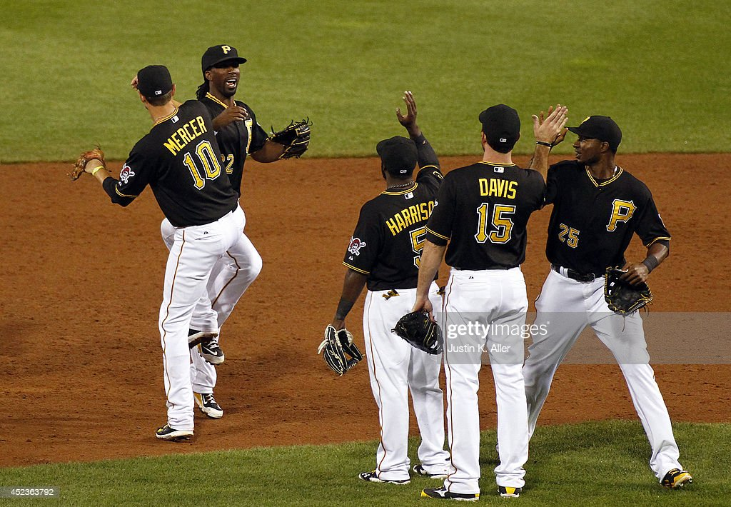 Andrew McCutchen #22 of the Pittsburgh Pirates celebrates with teammates after defeating the Colorado Rockies 4-2 at PNC Park July 18, 2014 in Pittsburgh, Pennsylvania.