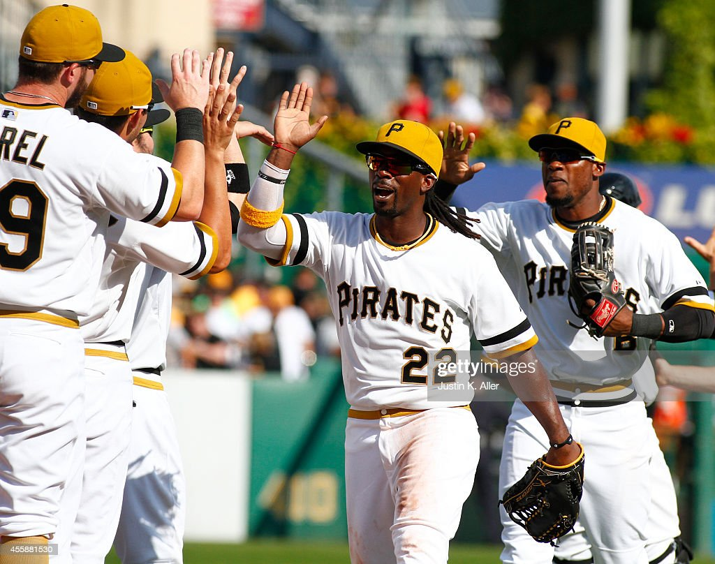 Andrew McCutchen of the Pittsburgh Pirates celebrates with teammates after defeating the Milwaukee Brewers 10 at PNC Park on September 21 2014 in...