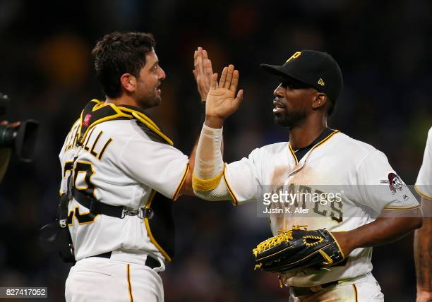 Andrew McCutchen of the Pittsburgh Pirates celebrates with teammates after defeating the Detroit Tigers 30 during interleague play at PNC Park on...