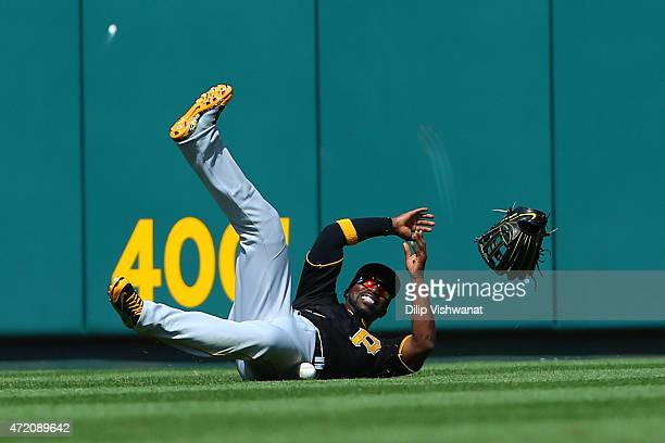 Andrew McCutchen of the Pittsburgh Pirates fails to catch a fly ball against the St Louis Cardinals in the seventh inning at Busch Stadium on May 3...