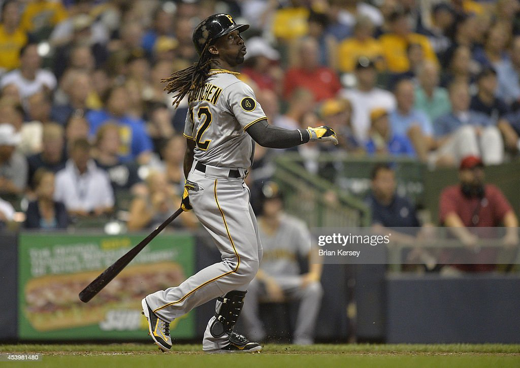 <a gi-track='captionPersonalityLinkClicked' href=/galleries/search?phrase=Andrew+McCutchen&family=editorial&specificpeople=2364814 ng-click='$event.stopPropagation()'>Andrew McCutchen</a> #22 of the Pittsburgh Pirates follows through on a solo home run during the fifth inning against the Milwaukee Brewers at Miller Park on August 22, 2014 in Milwaukee, Wisconsin.