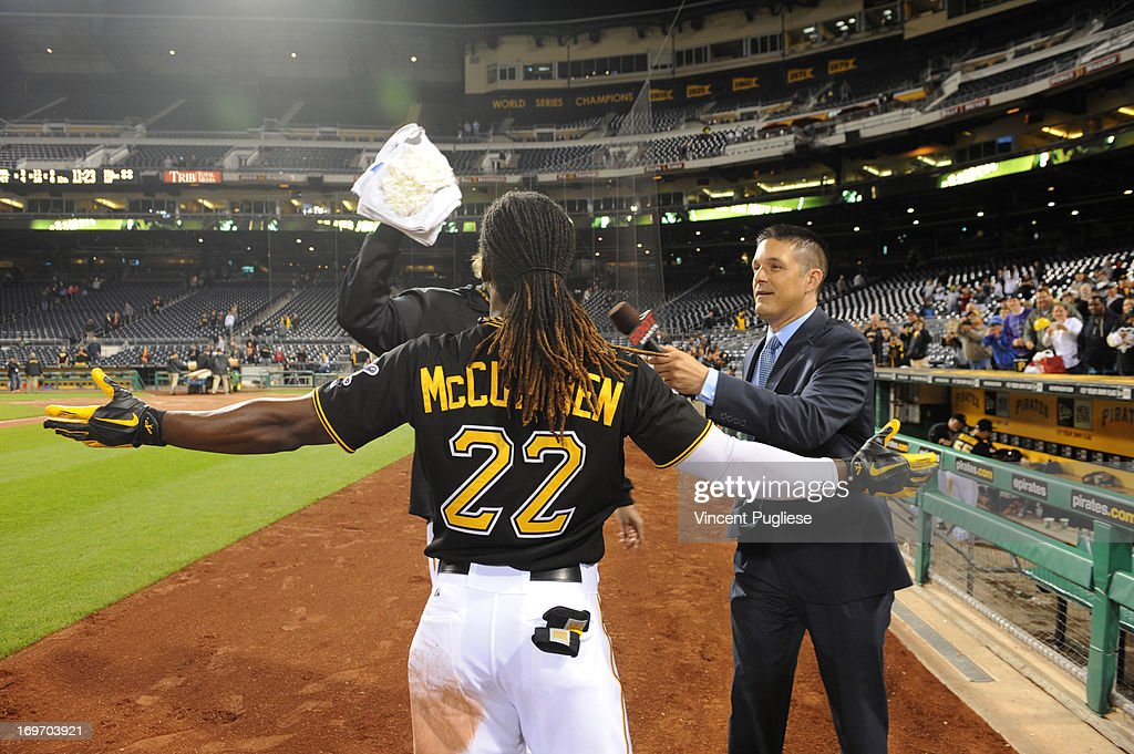 <a gi-track='captionPersonalityLinkClicked' href=/galleries/search?phrase=Andrew+McCutchen&family=editorial&specificpeople=2364814 ng-click='$event.stopPropagation()'>Andrew McCutchen</a> #22 of the Pittsburgh Pirates gets a face full of shaving cream from teammate <a gi-track='captionPersonalityLinkClicked' href=/galleries/search?phrase=A.J.+Burnett&family=editorial&specificpeople=213103 ng-click='$event.stopPropagation()'>A.J. Burnett</a> after hitting a game winning home run against the Milwaukee Brewers at PNC Park on May 14, 2013 in Pittsburgh, Pennsylvania.