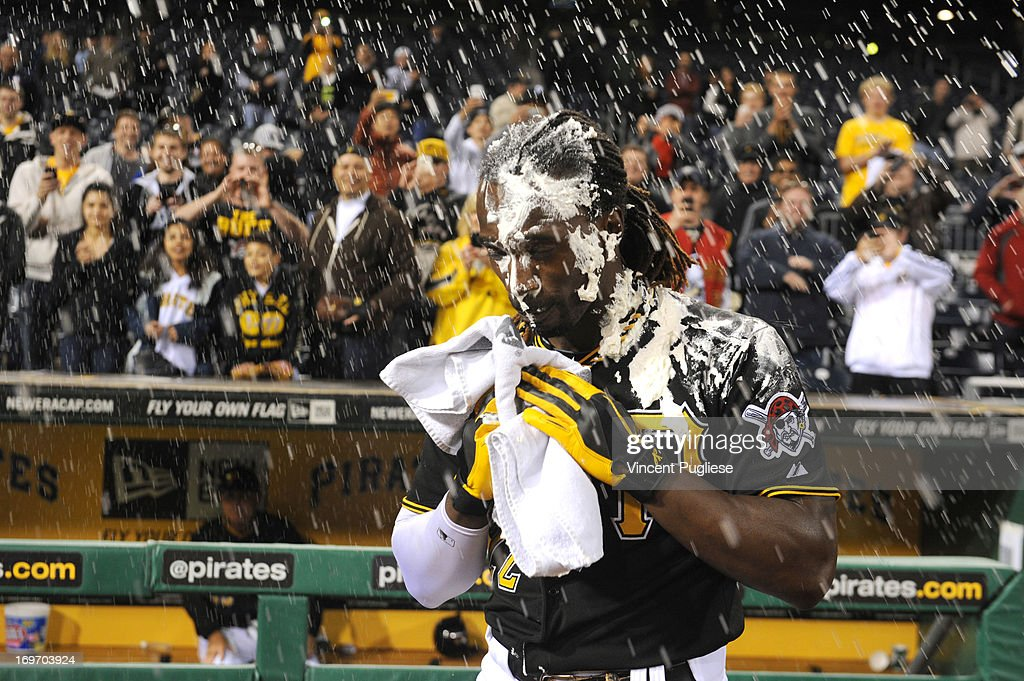 Andrew McCutchen #22 of the Pittsburgh Pirates gets a face full of shaving cream by teammate A.J. Burnett after hitting a game winning home run against the Milwaukee Brewers at PNC Park on May 14, 2013 in Pittsburgh, Pennsylvania.