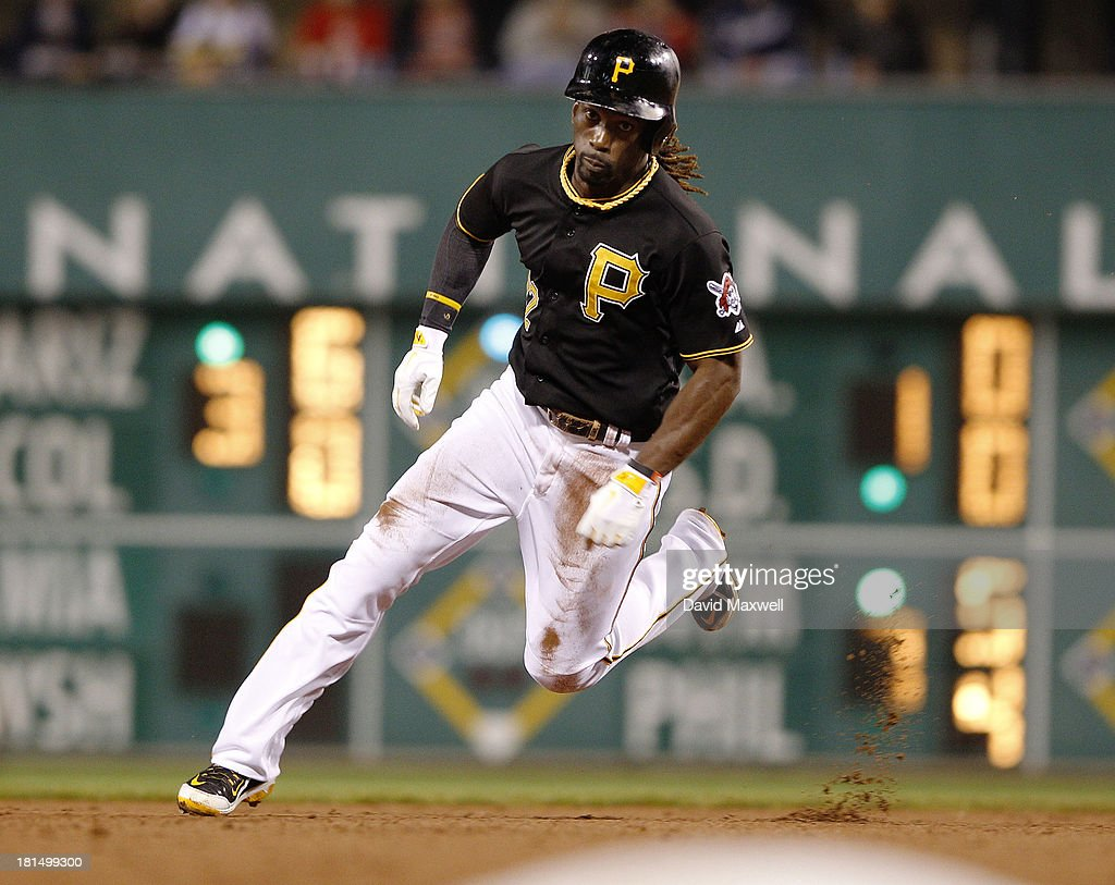 <a gi-track='captionPersonalityLinkClicked' href=/galleries/search?phrase=Andrew+McCutchen&family=editorial&specificpeople=2364814 ng-click='$event.stopPropagation()'>Andrew McCutchen</a> #22 of the Pittsburgh Pirates goes from first to third base on a botched pick-off attempt against the Cincinnati Reds during the sixth inning of their game on September 21, 2013 at PNC Park in Pittsburgh Pennsylvania. The Pirates defeated the Reds 4-2.