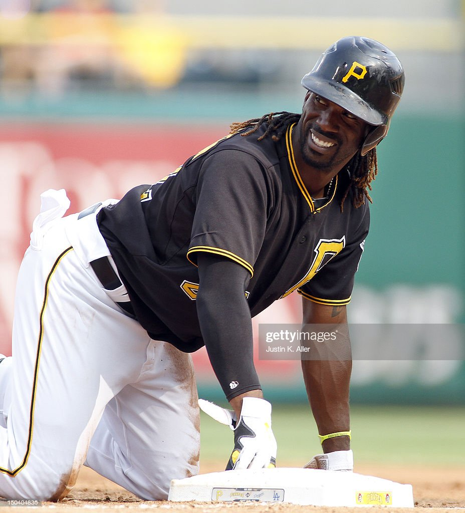 <a gi-track='captionPersonalityLinkClicked' href=/galleries/search?phrase=Andrew+McCutchen&family=editorial&specificpeople=2364814 ng-click='$event.stopPropagation()'>Andrew McCutchen</a> #22 of the Pittsburgh Pirates has a laugh while on base against the Los Angeles Dodgers during the game on August 16, 2012 at PNC Park in Pittsburgh, Pennsylvania.