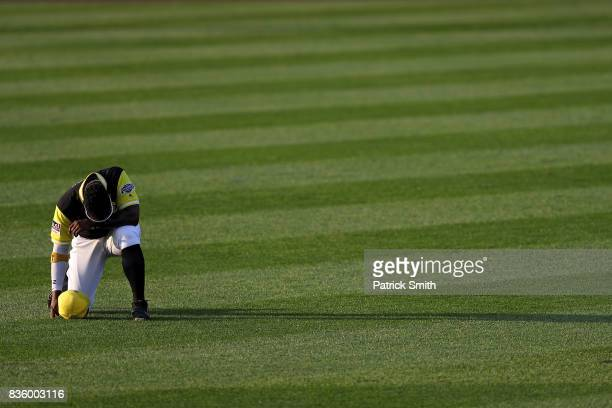 Andrew McCutchen of the Pittsburgh Pirates has a moment to himself before playing the St Louis Cardinals in the inaugural MLB Little League Classic...