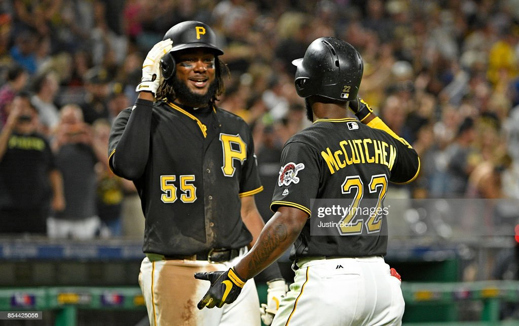 Andrew McCutchen #22 of the Pittsburgh Pirates high fives with Josh Bell #55 after hitting a three run home run in the sixth inning during the game against the Baltimore Orioles at PNC Park on September 26, 2017 in Pittsburgh, Pennsylvania.