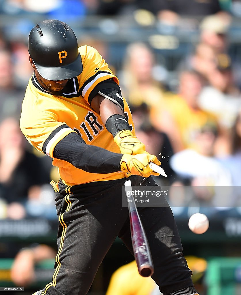 Andrew McCutchen #22 of the Pittsburgh Pirates hits a broken bat single during the eighth inning against the Cincinnati Reds on May 1, 2016 at PNC Park in Pittsburgh, Pennsylvania.