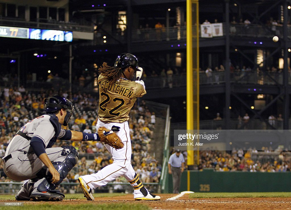 <a gi-track='captionPersonalityLinkClicked' href=/galleries/search?phrase=Andrew+McCutchen&family=editorial&specificpeople=2364814 ng-click='$event.stopPropagation()'>Andrew McCutchen</a> #22 of the Pittsburgh Pirates hits a double to left field in the sixth inning against the Houston Astros during the game on May 18, 2013 at PNC Park in Pittsburgh, Pennsylvania.