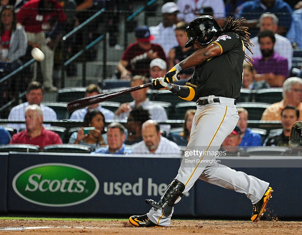 <a gi-track='captionPersonalityLinkClicked' href=/galleries/search?phrase=Andrew+McCutchen&family=editorial&specificpeople=2364814 ng-click='$event.stopPropagation()'>Andrew McCutchen</a> #22 of the Pittsburgh Pirates hits a fifth inning two-run home run against the Atlanta Braves at Turner Field on September 24, 2014 in Atlanta, Georgia.