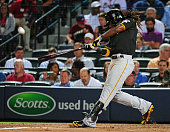 Andrew McCutchen of the Pittsburgh Pirates hits a fifth inning tworun home run against the Atlanta Braves at Turner Field on September 24 2014 in...