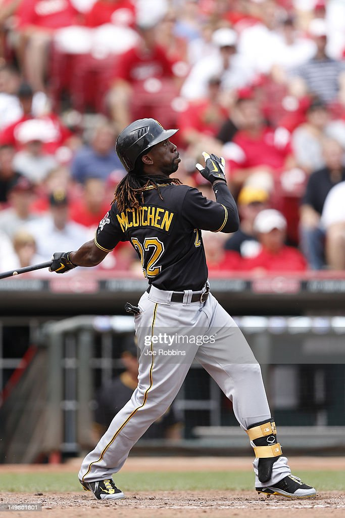 <a gi-track='captionPersonalityLinkClicked' href=/galleries/search?phrase=Andrew+McCutchen&family=editorial&specificpeople=2364814 ng-click='$event.stopPropagation()'>Andrew McCutchen</a> #22 of the Pittsburgh Pirates hits a home run in the ninth inning of the game against the Cincinnati Reds at Great American Ball Park on August 5, 2012 in Cincinnati, Ohio. The Pirates won 6-2.
