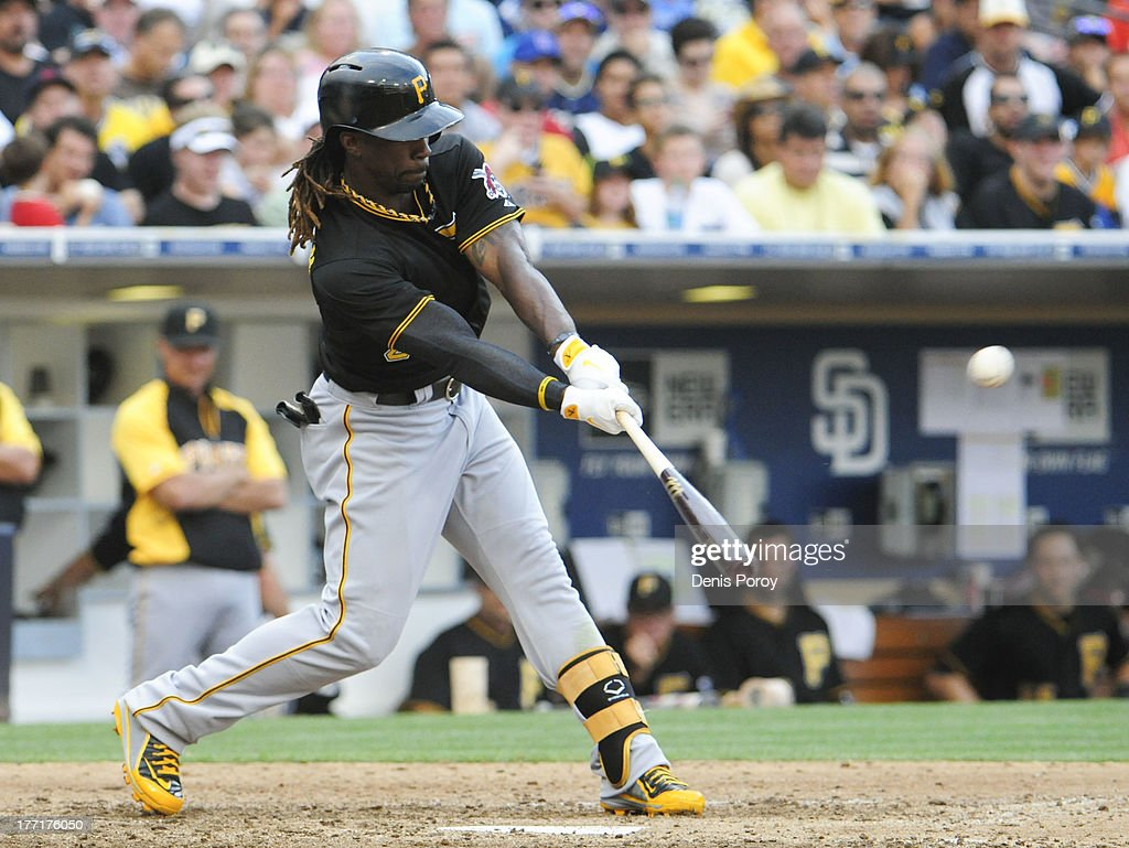 <a gi-track='captionPersonalityLinkClicked' href=/galleries/search?phrase=Andrew+McCutchen&family=editorial&specificpeople=2364814 ng-click='$event.stopPropagation()'>Andrew McCutchen</a> #22 of the Pittsburgh Pirates hits a sacrifice fly ball during the eighth inning of a baseball game against the San Diego Padres at Petco Park on August 21, 2013 in San Diego, California.