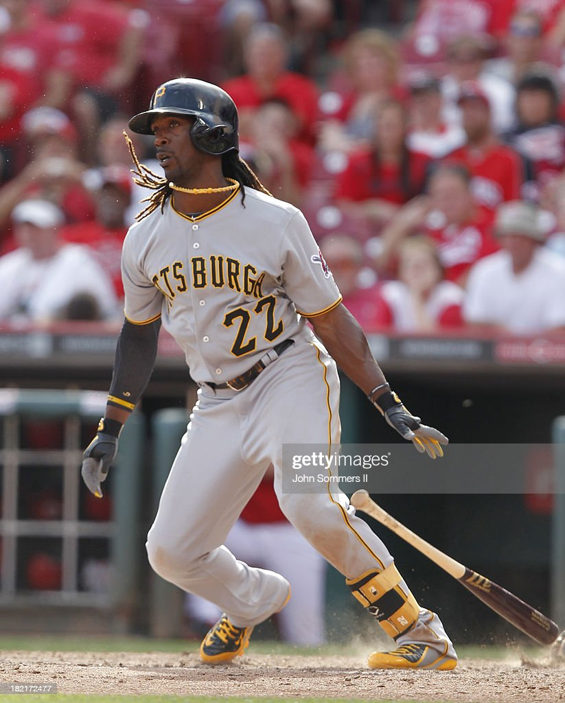 <a gi-track='captionPersonalityLinkClicked' href=/galleries/search?phrase=Andrew+McCutchen&family=editorial&specificpeople=2364814 ng-click='$event.stopPropagation()'>Andrew McCutchen</a> #22 of the Pittsburgh Pirates hits a single during their game against the Cincinnati Reds at Great American Ball Park on September 28, 2013 in Cincinnati, Ohio.