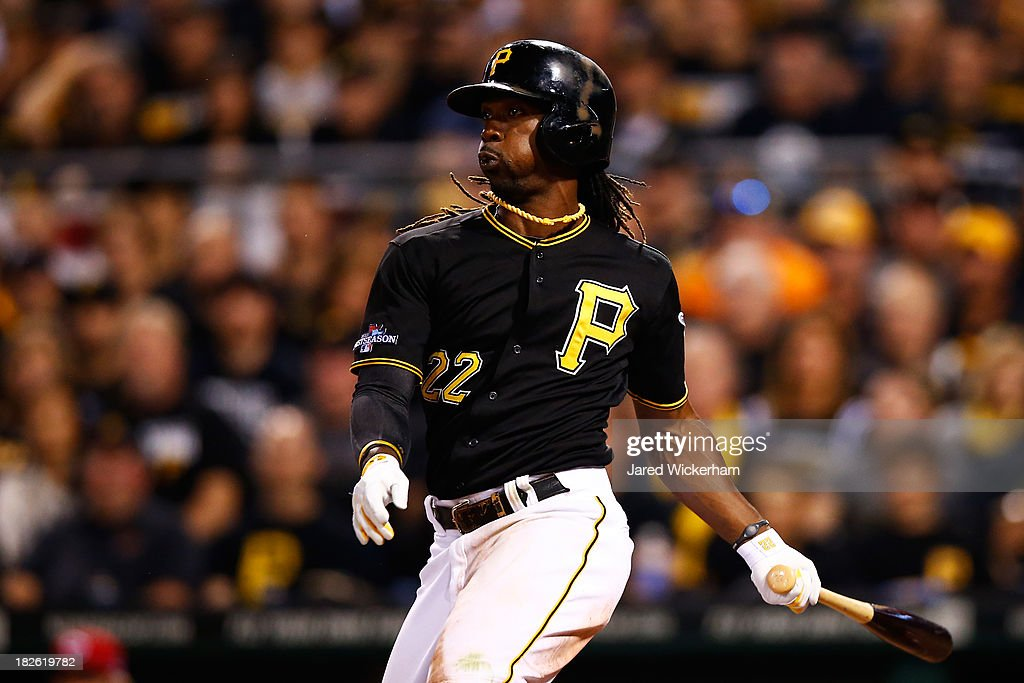 <a gi-track='captionPersonalityLinkClicked' href=/galleries/search?phrase=Andrew+McCutchen&family=editorial&specificpeople=2364814 ng-click='$event.stopPropagation()'>Andrew McCutchen</a> #22 of the Pittsburgh Pirates hits a single in the sixth inning against the Cincinnati Reds during the National League Wild Card game at PNC Park on October 1, 2013 in Pittsburgh, Pennsylvania.