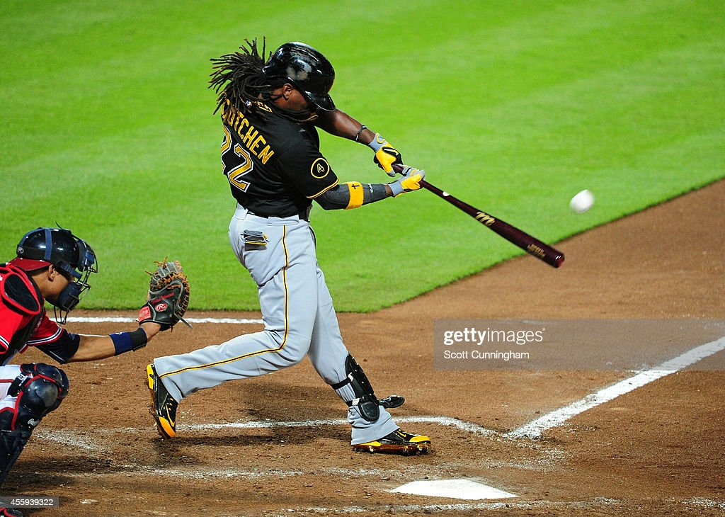 <a gi-track='captionPersonalityLinkClicked' href=/galleries/search?phrase=Andrew+McCutchen&family=editorial&specificpeople=2364814 ng-click='$event.stopPropagation()'>Andrew McCutchen</a> #22 of the Pittsburgh Pirates hits a sixth inning solo home run against the Atlanta Braves at Turner Field on September 22, 2014 in Atlanta, Georgia.