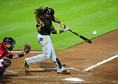Andrew McCutchen of the Pittsburgh Pirates hits a sixth inning solo home run against the Atlanta Braves at Turner Field on September 22 2014 in...