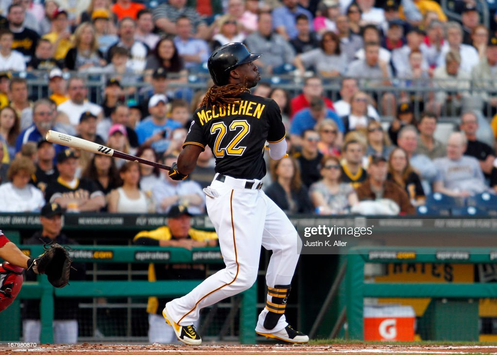 <a gi-track='captionPersonalityLinkClicked' href=/galleries/search?phrase=Andrew+McCutchen&family=editorial&specificpeople=2364814 ng-click='$event.stopPropagation()'>Andrew McCutchen</a> #22 of the Pittsburgh Pirates hits a solo home run in the first inning against the Washington Nationals during the game on May 3, 2013 at PNC Park in Pittsburgh, Pennsylvania.