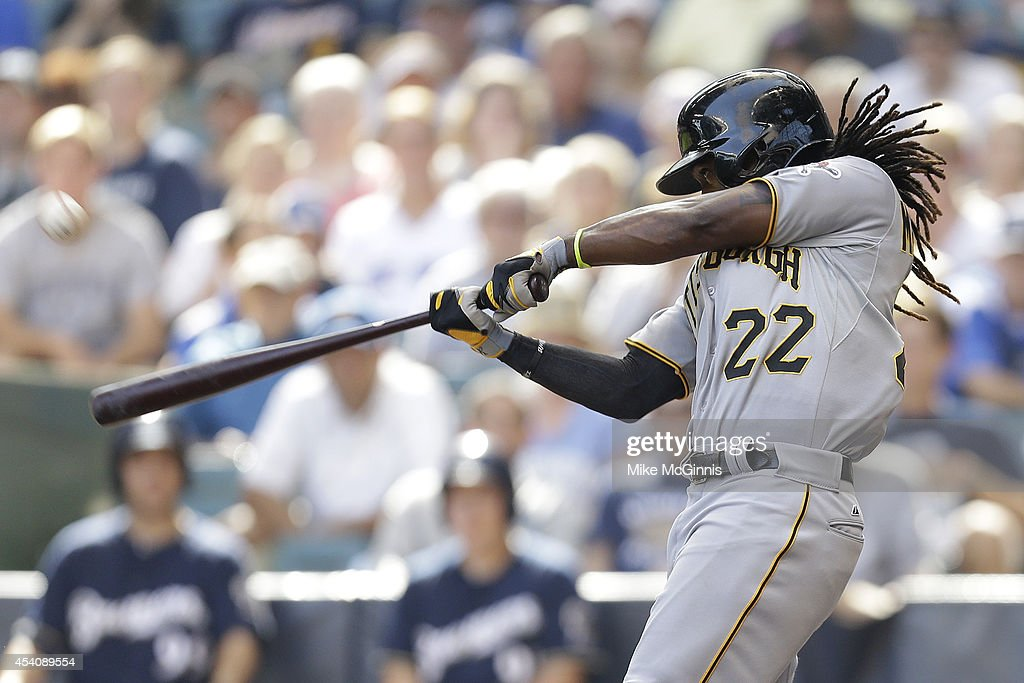 Andrew McCutchen #22 of the Pittsburgh Pirates hits a solo home run in the top of the ninth inning against the Milwaukee Brewers at Miller Park on August 24, 2014 in Milwaukee, Wisconsin.
